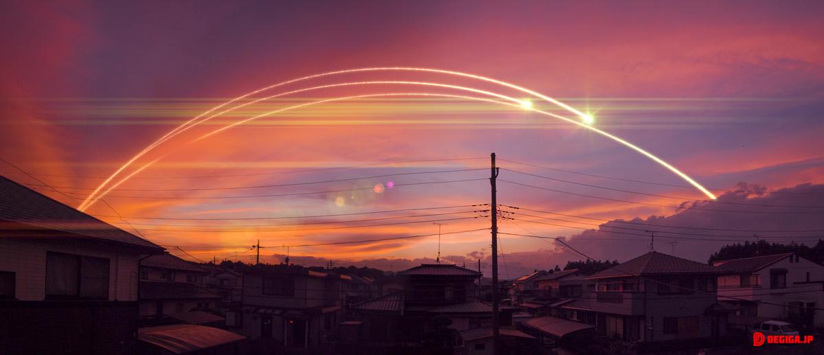 夕焼けとミサイルの光跡