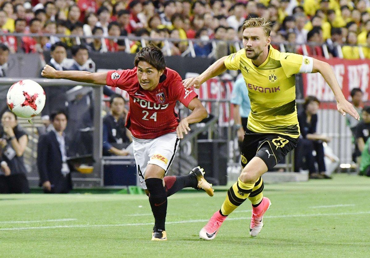 Late Andre Schurrle strike gives Dortmund 3-2 win over Japan's Urawa Reds